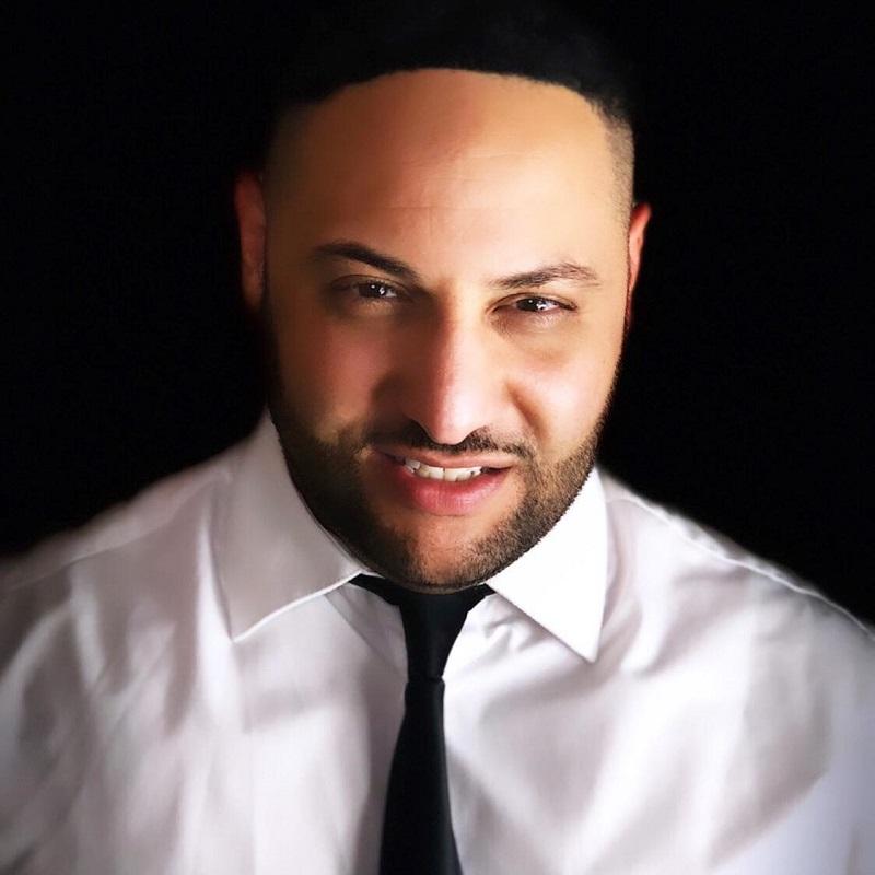 Headshot of Tarq Ramadan.