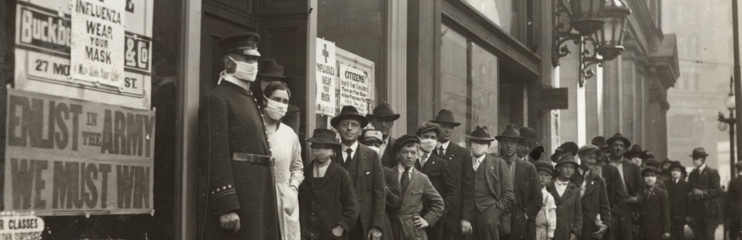 People with masks line up on street during 1918 Spanish Flu Pandemic