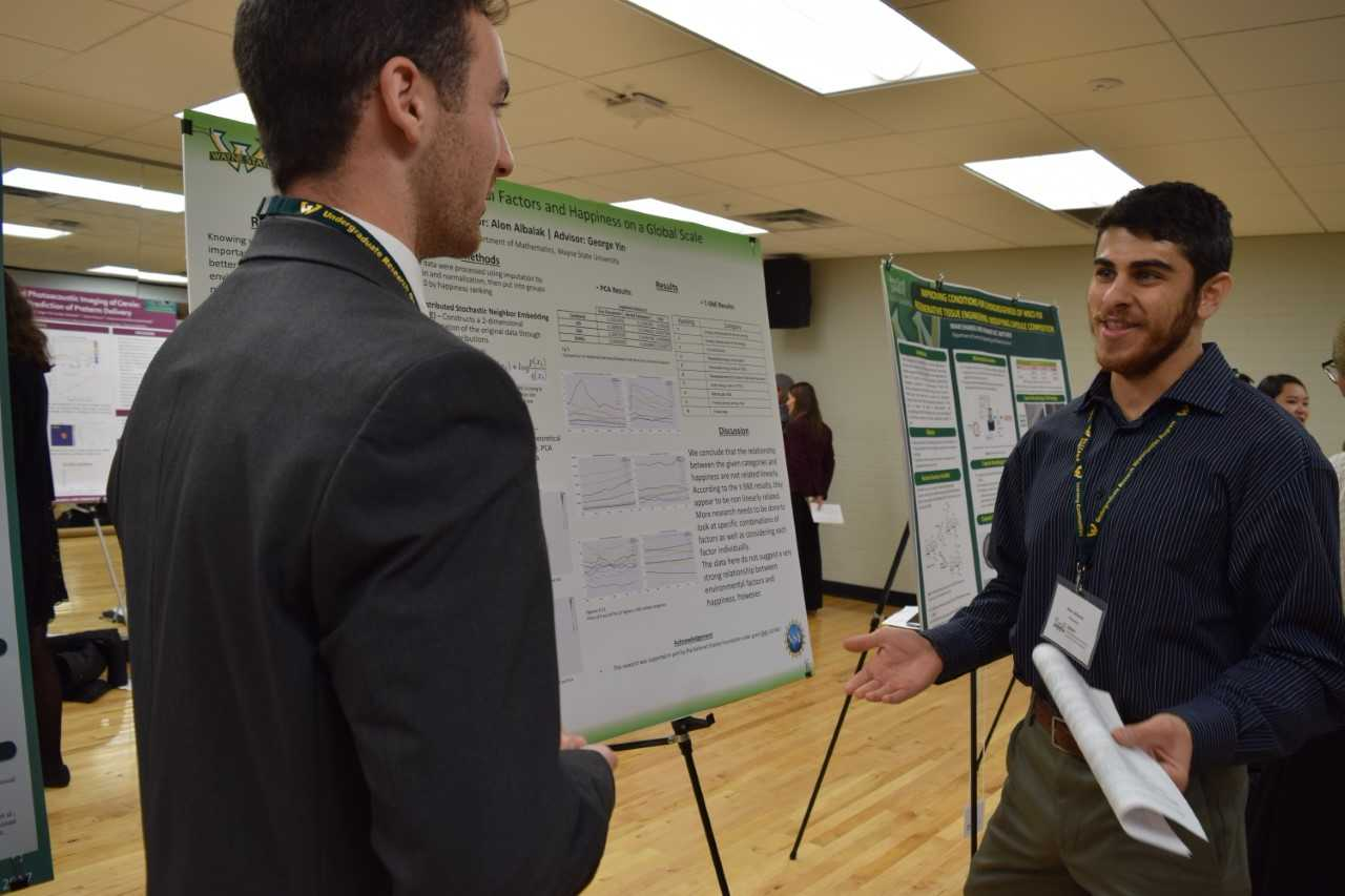 Alon Albalak, right, discusses his research with a fellow student.
